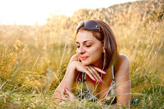 Beautiful woman lying in grass Royalty Free Stock Photography
