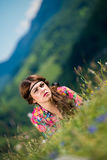 Beautiful woman lying on the grass Stock Photo