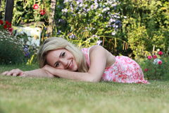 Beautiful woman lying on the grass Stock Image