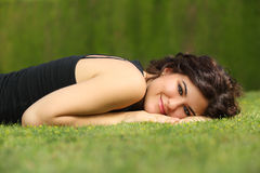 Beautiful woman lying on the grass relaxed Royalty Free Stock Photo