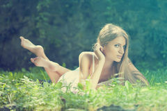 Beautiful Woman lying on the grass, rest in nature Royalty Free Stock Image