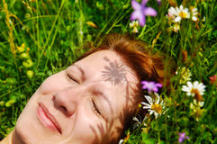 Beautiful woman lying on the grass and smiling stock photo
