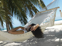 Beautiful woman lying in hammock Stock Image