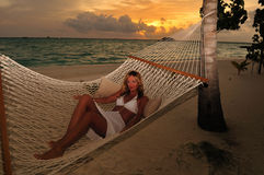 Beautiful woman lying in hammock Stock Photography