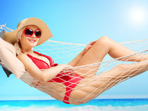 Beautiful woman lying in a hammock at a beach Stock Photography