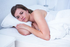 Beautiful woman lying in her bed Royalty Free Stock Images