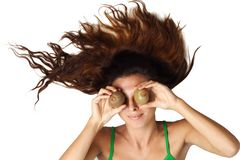 Beautiful woman lying and hold kiwi near eyes Stock Photos