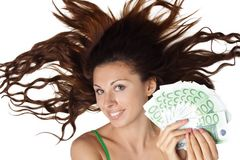 Beautiful woman lying and hold money euro royalty free stock photography