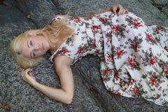 Beautiful Woman Lying On Large Rock Royalty Free Stock Image