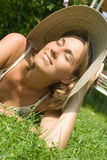 Beautiful woman lying on the lawn Stock Photo
