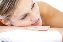 Beautiful woman lying on a massage table Royalty Free Stock Photo