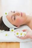Beautiful woman lying on massage table in beauty salon Royalty Free Stock Photos