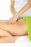 Beautiful woman lying on a massage table and has massage. Royalty Free Stock Photography