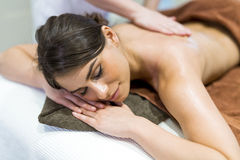 Beautiful woman lying on a massage table and relaxing Stock Image
