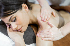 Beautiful woman lying on a massage table and relaxing Stock Images