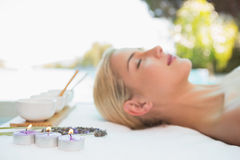 Beautiful woman lying on massage table at spa center Royalty Free Stock Photos