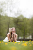 Beautiful woman lying in a meadow Stock Images