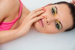 Beautiful woman lying in milky water Stock Photos