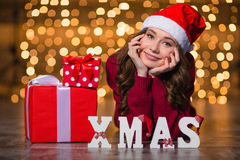 Beautiful woman lying near letters spelling word Xmas and  gifts Stock Image