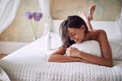 Free Beautiful Woman Lying On Bed At Home At Morning Royalty Free Stock Image - 181181526