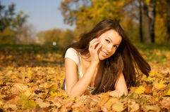 Beautiful woman lying in the park Royalty Free Stock Photos