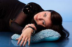 Beautiful woman lying on pillows Royalty Free Stock Image