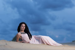Beautiful woman lying on a sand dune Royalty Free Stock Photo
