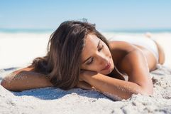 Beautiful woman lying on sand Royalty Free Stock Photography
