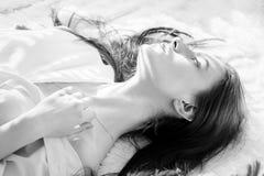 Beautiful woman lying Stock Photography