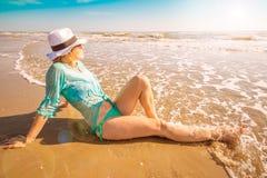 Beautiful woman lying on the shore Royalty Free Stock Photo