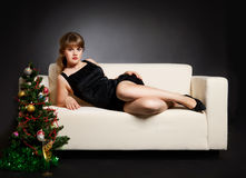 Beautiful woman lying on the sofa Royalty Free Stock Photos