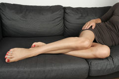 Beautiful woman  lying on sofa Stock Image