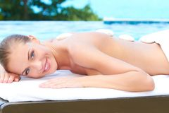 Beautiful woman lying on spa bed at outdoor Stock Photography