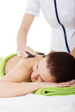Beautiful woman lying on spa salon. Stock Photos