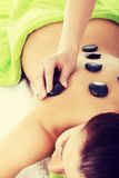 Beautiful woman lying on spa salon. Royalty Free Stock Photography