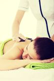 Beautiful woman lying on spa salon. Royalty Free Stock Image