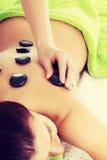 Beautiful woman lying on spa salon. Stock Photography