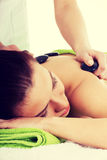 Beautiful woman lying on spa salon. Royalty Free Stock Photos