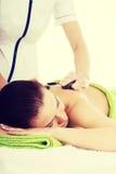 Beautiful woman lying on spa salon. Stock Photos