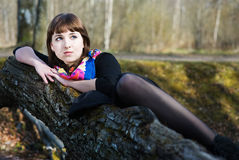 Beautiful woman lying on the tree Stock Photography
