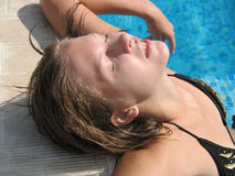 Beautiful woman lying in water pool Royalty Free Stock Image