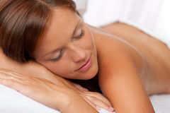 Beautiful woman lying in white bed Royalty Free Stock Photography