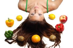 Beautiful Woman Lying With Fruits And Hair Royalty Free Stock Images