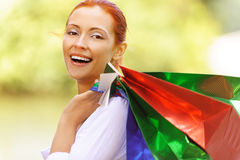 Beautiful woman made  purchase at Royalty Free Stock Photography