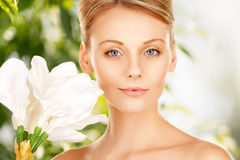 Beautiful woman with madonna lily Stock Photos