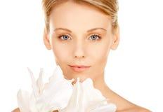 Beautiful woman with madonna lily Stock Photo