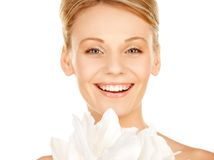 Beautiful woman with madonna lily Royalty Free Stock Image