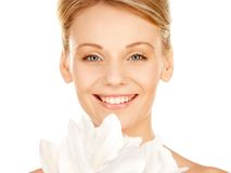 Beautiful woman with madonna lily Royalty Free Stock Photo