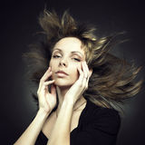 Beautiful woman with magnificent hair Stock Image