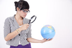 Beautiful woman with magnifying glass Stock Photo